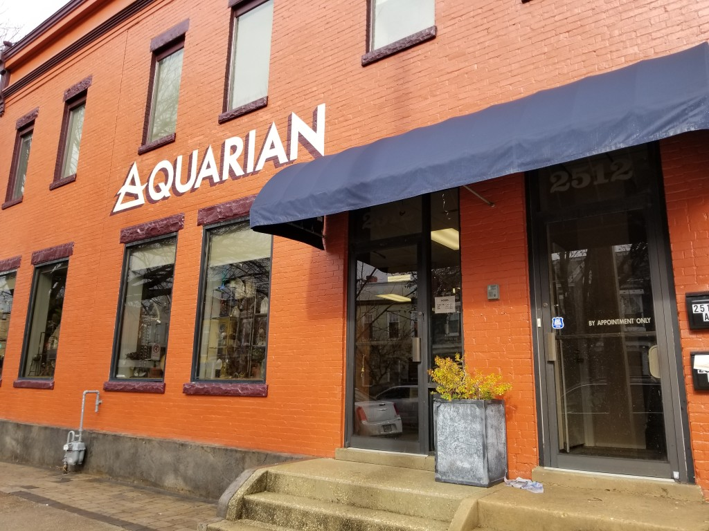 Aquarian New Location at 2512 W Main St. Photo of painted brick building with