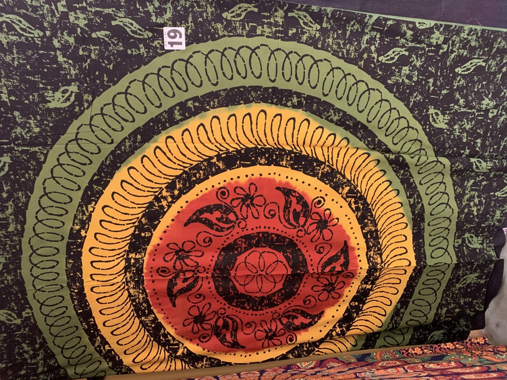 Red, Yellow, Green and Black Tapestry with a circular motif