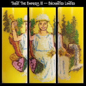 """Text: """"Tarot: The Empress III - Enchanted Limited"""" Pictured: On a yellow candle, depicted in glitter a seated woman with a crown of stars, draped in a white and blue chiton, holding a gold scepter and a sheaf of wheat, a forest and waterfall in the background, pillows supporting her seated form"""