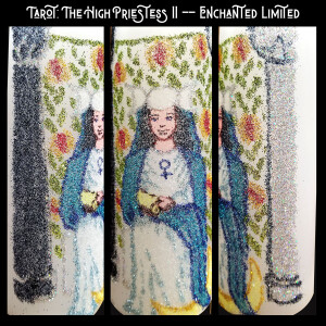 """Text: Tarot: The High Priestess II - Enchanted Limited"""" Image: A triptych, depicted on a white candle in glitter, a female figure with dark hair, crowned with a triple moon, dressed in white and blue clothing, seated between black and white pillars, a drape of cloth printed with pomegranates and leaves stretched behind her"""